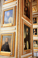 A series of portraits on display at the Palace of Versailles, on the outskirts of Paris, France.