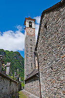 The old stone church tower at Aurigeno, Ticino, Switzerland under the brilliant blue spring sky.