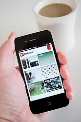 Using Flipboard social networking app on an iPhone 4g smart phone
