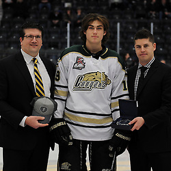 COBOURG, ON - Feb 10 : Ontario Junior Hockey League Game Action between the Cobourg Cougars and the Georgetown Raiders , Brent Tully GM of Cobourg Cougars Hockey Club and Brent Garbutt award Mason Marchment #19 with player of the month during the pre-game ceremony.<br /> (Photo by Andy Corneau / OJHL Images)