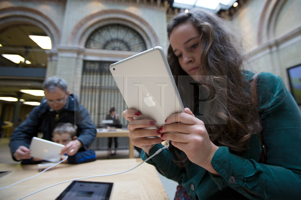 © licensed to London News Pictures. London, UK 02/11/2012. People looking at iPad Mini at Apple Store in Covent Garden, London as highly anticipated tablet meets the costumers on 02/11/12. Photo credit: Tolga Akmen/LNP