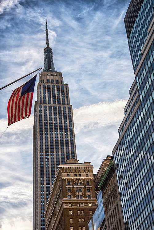 The Empire State Building from 32st with a US flag in the foreground