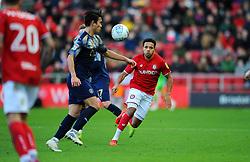 Korey Smith of Bristol City applies pressure on Kenny Dougall of Barnsley-Mandatory by-line: Nizaam Jones/JMP - 18/01/2020 - FOOTBALL - Ashton Gate - Bristol, England - Bristol City v Barnsley - Sky Bet Championship