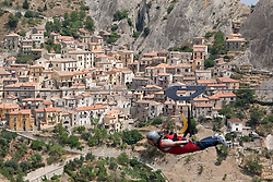 Castelmezzano/Basilicata/Italy - Aug 02, 2009 - Fly of the Angel. The two towns of Pietrapertosa and Castelmezzano in the Italian Dolomites decided they wanted to attract more tourists.<br /> One suggested it was a shame they could not fly to the other village - and the idea of the &quot;Flight of the Eagles&quot; device - a mile-long metal cable suspended between two peaks - was born. Those willing to take up the challenge hang from a harness connected to the steel rope and then jump off from a special platform to travel across the valley which is 500m below.<br /> Riders can reach speeds of up to 90mph.