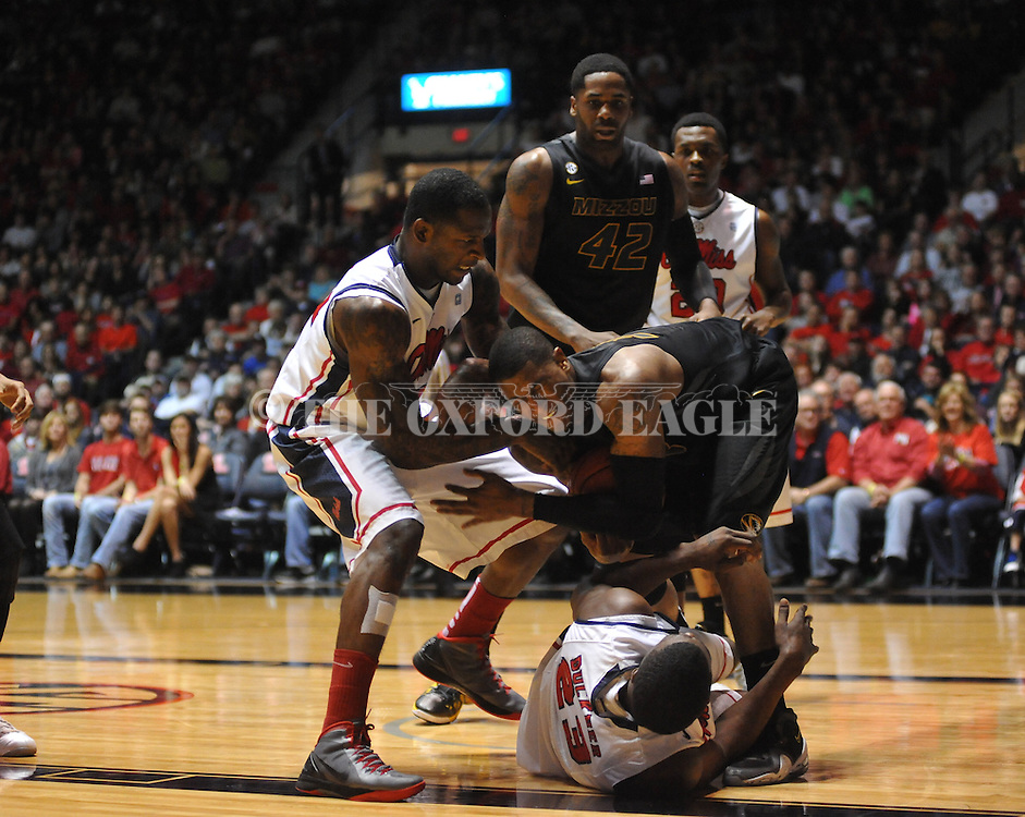 "Mississippi's Murphy Holloway (31) and Missouri's Earnest Ross (33) battle for the ball with Mississippi's Reginald Buckner (23) and Missouri's Alex Oriakhi (42) at the C.M. ""Tad"" Smith Coliseum on Saturday, January 12, 2013. Mississippi won 64-49. (AP Photo/Oxford Eagle, Bruce Newman)"