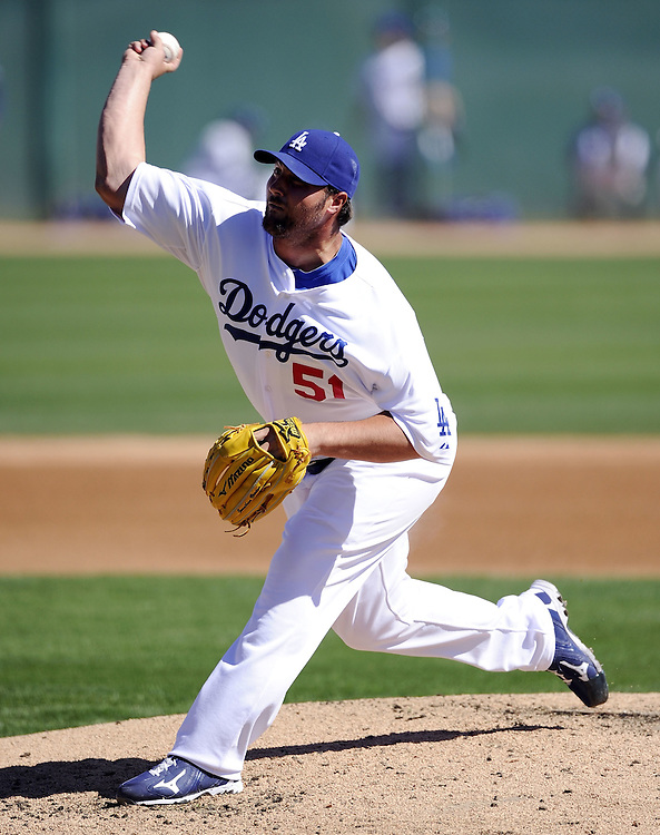 GLENDALE, AZ - FEBRUARY 28:  Jonathan Broxton #51 of the Los Angeles Dodgers pitches against the Chicago White Sox on February 28, 2011 at The Ballpark at Camelback Ranch in Glendale, Arizona.  The Dodgers defeated the White Sox 6-5.  (Photo by Ron Vesely)