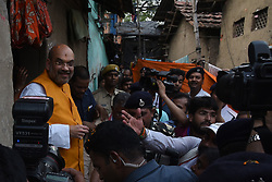 April 26, 2017 - Kolkata, West Bengal, India - India ruling political party BJP National President Amit Shah  visit a slum in South Kolkata situated in Chief Minister Mamata Banerjee's constituency.However, the BJP leaders had to take a lot of pain to find a spot in Bhowanipore Assembly constituency where development has not taken place since 2011. Over the past five years, massive development has taken place in South Kolkata. Waterlogging and drinking water scarcity are a matter of the past now. All the main thoroughfares and even lanes and by-lanes are brightly illuminated. Sweeping on major roads take twice a day. Slums like Peyarabagan and Beltola have been developed. Finding no other place, the state BJP leaders will take Shah to a slum situated in Chetla where the state Urban Development minister has brought about major infrastructural development in the past few years. It was learnt that Shah will also visit five houses to talk to the residents and state BJP leadership has kept it a secret. The TMC leaders in South Kolkata have asked party workers not to fall into any kind of provocation.On April 26,2017 in Kolkata,India. (Credit Image: © Debajyoti Chakraborty/NurPhoto via ZUMA Press)