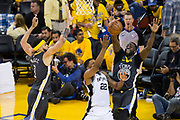 Golden State Warriors forward Draymond Green (23) blocks a shot by San Antonio Spurs forward Rudy Gay (22) during Game 2 of the Western Conference Quarterfinals at Oracle Arena in Oakland, Calif., on April 16, 2018. (Stan Olszewski/Special to S.F. Examiner)
