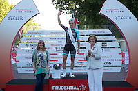 Sprint competition winner  winner Peter Williams on the podium after The Surrey 100 during The Prudential RideLondon weekend.<br /> Sunday 2nd August 2015. <br /> <br /> Prudential RideLondon is the world's greatest festival of cycling, involving 95,000+ cyclists – from Olympic champions to a free family fun ride - riding in five events over closed roads in London and Surrey over the weekend of 1st and 2nd August 2015. <br /> <br /> Photo: Paul Gregory<br /> <br /> See www.PrudentialRideLondon.co.uk for more.<br /> <br /> For further information: Penny Dain 07799 170433<br /> pennyd@ridelondon.co.uk