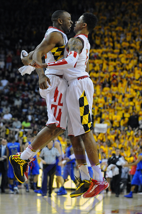 16 February 2013:   Maryland Terrapins guard/forward Dez Wells (32) leaps with guard Nick Faust (5) after scoring in action against the Duke Blue Devils at the Comcast Center in College Park, MD. where the Maryland Terrapins defeated the Duke Blue Devils, 83-81.