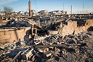 November 6th, NY, New York,  The remains of Over 100 homes in Breezy Point , Queens that burnt to the ground when superstorm Sandy hit, in what Mayor Bloomberg called New York City's worst fire ever. Hurricane Sandy hit the try-state area as a tropical storm causing billions of dollars of damage and cutting electricity to hundreds of thousands. Extreme weather is being blamed on climate change by many scientist.
