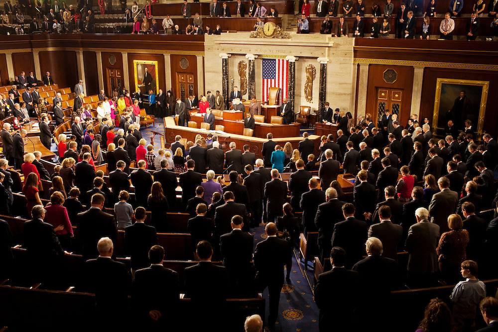 Heads bow during the introductory prayer prior to congressmen being sworn in to office at the United States Capital in Washington, DC on Wednesday, January 5, 2011. He will be a member of the 112th Congress, and represents the 11th Congressional District.