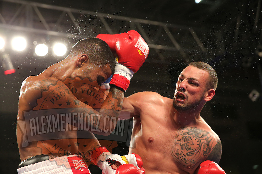 Michael Ramos (R) fights against Anthony Arvelo during a Telemundo boxing match at the Kissimmee Civic Center on Friday, July 17, 2015 in Kissimmee, Florida.  Ramos won the bout. (AP Photo/Alex Menendez)