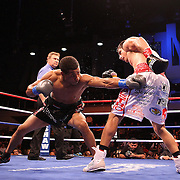 Fighter Mauricio Herrera (right) and Champion Karim Mayfield fight for the NABO Junior Welterweight Belt during the HBO Triple Explosion fight at the Turning Stone Resort Casino in Verona, NY, on Saturday, Oct 27, 2012. (AP Photo/Alex Menendez)