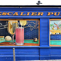 L'Escalier Pub Wall Mural in Nice, France<br /> I love finding great street art such as this colorful trompe l'oeil mural of a billiard table with cocktails and ashtray on the side of the L'Escalier Pub. Inside were pool tables and a bar surrounded by stone arches and accompanied by a live DJ and karaoke. It is located on Rue Raoul Basio just a few steps away from the costal promenade called Quai des États-Unis. Unfortunately, since this photo was taken, the mural is gone and the pub has closed.