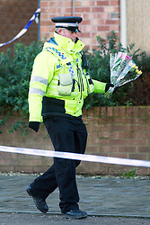 © Licensed to London News Pictures. 03/02/2016. Allerton Bywater UK. Flowers are laid at the scene of a police investigation that is still underway at a property on Beeston Way in Allerton Bywater after the bodies of two children & a woman were found at the property. Photo credit: Andrew McCaren/LNP