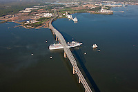 Aerial shot of Pride of Baltimore 2 leading Carnival Pride cruise ship under Key Bridge in Baltimore Maryland