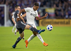 April 21, 2018 - Orlando, FL, U.S. - ORLANDO, FL - APRIL 21: Orlando City midfielder Will Johnson (4) pokes the ball away during the MLS soccer match between the Orlando City FC and the San Jose Earthquakes at Orlando City SC on April 21, 2018 at Orlando City Stadium in Orlando, FL. (Photo by Andrew Bershaw/Icon Sportswire) (Credit Image: © Andrew Bershaw/Icon SMI via ZUMA Press)