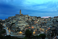 "Matera has gained international fame for its ancient town, the ""Sassi di Matera"" (meaning ""stones of Matera""). The Sassi originate from a prehistoric (troglodyte) settlement, and are suspected to be some of the first human settlements in Italy."