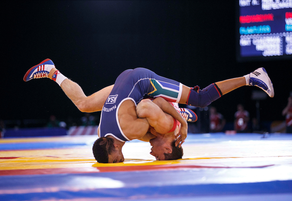 Wrestling. 61KG Repechage. Sasha Madyarchyk of England (red) versus Marno Plaatjies of South Africa (blue).