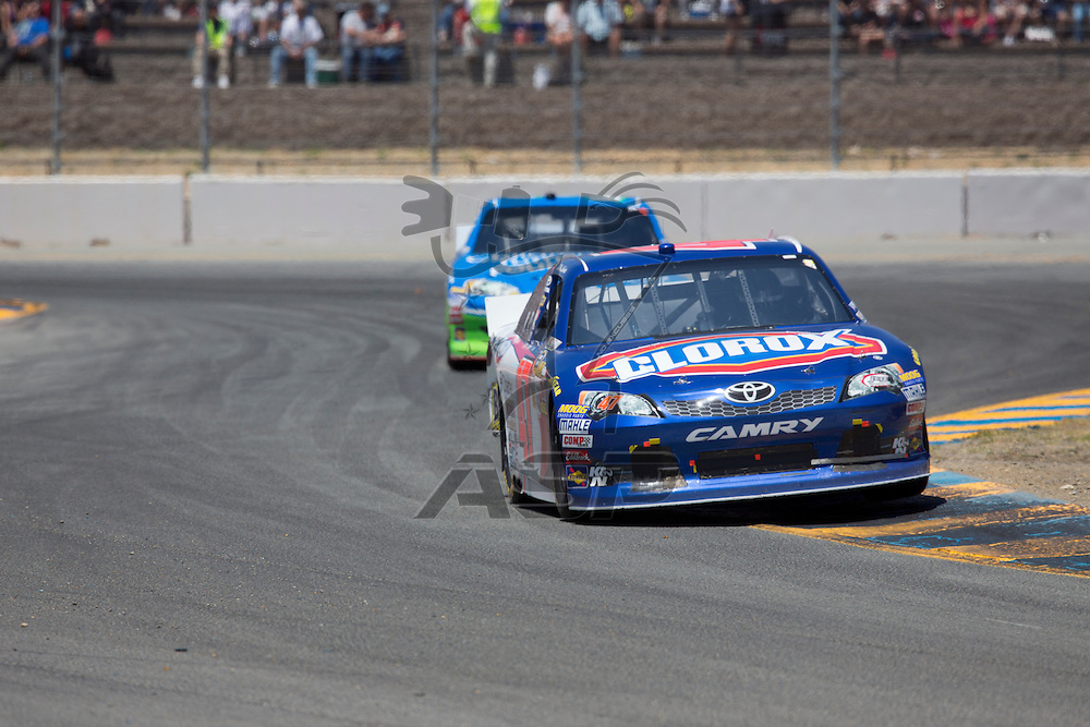 SONOMA, CA - JUN 24, 2012:  Bobby Labonte (47) brings his car through the turns during the Toyota Save Mart 350 at the Raceway at Sonoma in Sonoma, CA.