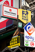 A finance shop advertising Western Union, Money Gram, Pay Point, and epay. Stamford Hill, London.