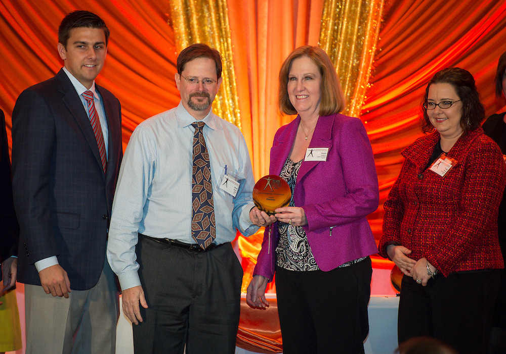 Houston ISD Benefits general manager Brad Bailey and manager Susan Jenkins, center, accept an award from the Houston Business Journal for being one of the healthiest workplaces in the Houston area, April 4, 2014.