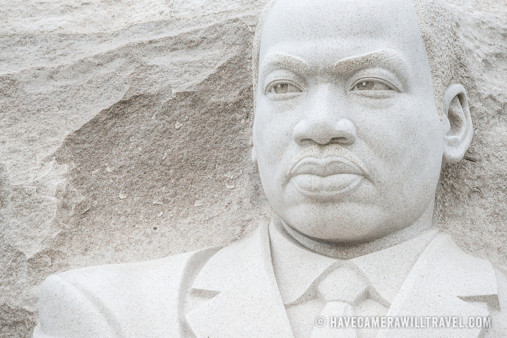 A wide-angle shot of the central statue of the Martin Luther King Jr Memorial on the Tidal Basin in Washington DC.