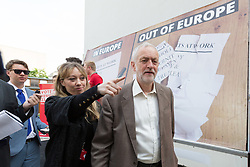 "© Licensed to London News Pictures. 07/06/2016. LONDON, UK.  JEREMY CORBYN walks past an ""out of Europe"" sign as he leaves the launch of a new poster for the 'Labour In for Britain' campaign, to Remain in the European Union (EU) at Green Space in London..  Photo credit: Vickie Flores/LNP"