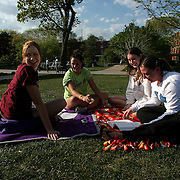 Drake students relax on the campus lawn near their residence hall.  photo by david peterson