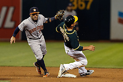 OAKLAND, CA - JULY 19:  Jake Smolinski #5 of the Oakland Athletics is tagged out attempting to steal second base by Jose Altuve #27 of the Houston Astros during the fifth inning at the Oakland Coliseum on July 19, 2016 in Oakland, California. (Photo by Jason O. Watson/Getty Images) *** Local Caption *** Jake Smolinski; Jose Altuve
