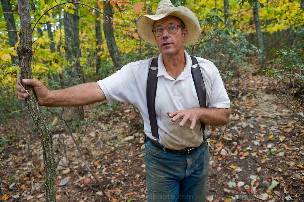 Joel Salatin, a farmer and author, in a wood lot near his farm in Virginia's Shenandoah Valley. (Joel Salatin is featured in the book What I Eat: Around the World in 80 Diets.)  MODEL RELEASED.