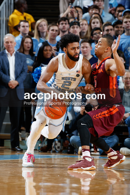 CHAPEL HILL, NC - JANUARY 26: Joel Berry II #2 of the North Carolina Tar Heels dribbles around Justin Robinson #5 of the Virginia Tech Hokies on January 26, 2017 at the Dean Smith Center in Chapel Hill, North Carolina. North Carolina won 91-72. (Photo by Peyton Williams/UNC/Getty Images) *** Local Caption *** Joel Berry II;Justin Robinson