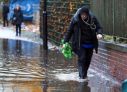 © Licensed to London News Pictures. 22/11/2016. Rotherham, UK. A man wades through a flooded road in Rotherham, South Yorkshire, after a river broke it's banks last night. Storm Angus has brought heavy wind and rain to much of the UK this week with flooding seen all over. Photo credit : Ian Hinchliffe/LNP