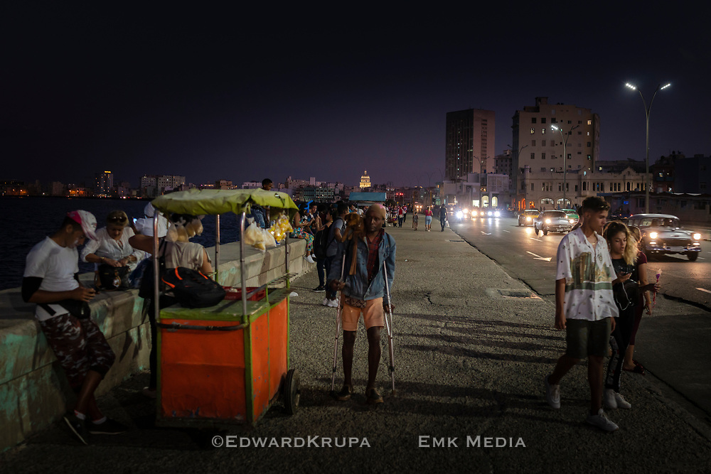 People at the Malecon in the Vedado area of Havana,