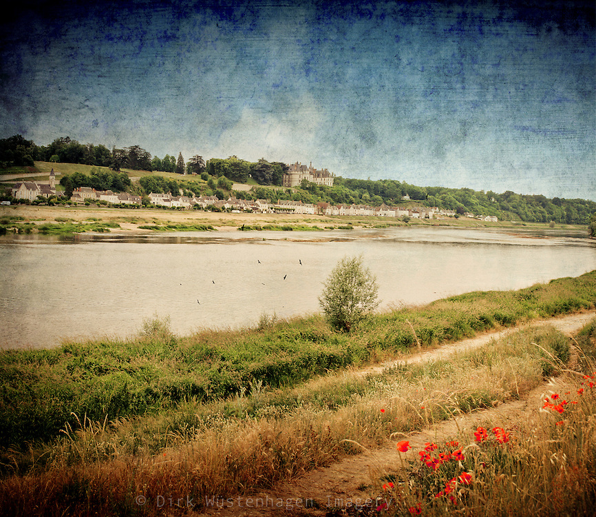 View on river Loire and Chaumont-sur-Loire with castle in the center of France. Textured photography