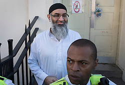 © Licensed to London News Pictures. 19/10/2018. London, UK. Radical preacher ANJEM CHOUDARY smiles as stands outside a bail hostel after being released form Belmarsh Prison in south-east London. Photo credit: Peter Macdiarmid/LNP