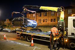 © Licensed to London News Pictures. 04/12/2019. London, UK. A vehicle being removed form the crime scene at Walerton Road in Maida Hill, West London, were a man was shot yesterday evening. The teenager, who was found with gunshot wounds, is currently in a critical condition in hospital. Photo credit: Ben Cawthra/LNP