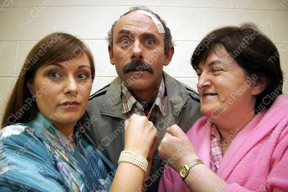 Terace McGoldrick - Barbara Smith, John Condey - John Smith and Liza Nagle - Mary Smith go through one of their scenes as the Kildysart Players get ready to go on stage in Doonbeg to perform their production of Ray Cooney's 'Run For Your Wife' on Thursday night.<br />