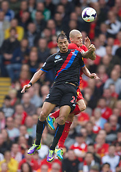 LIVERPOOL, ENGLAND - Saturday, October 5, 2013: Liverpool's Martin Skrtel in action against Crystal Palace's Marouane Chamakh during the Premiership match at Anfield. (Pic by David Rawcliffe/Propaganda)
