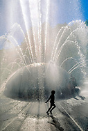 girl playing in water of Seattle Center fountain