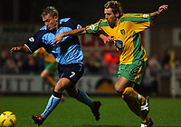 PIC BY DANIEL HAMBURY/SPORTSBEAT IMAGES<br /><br />Norwich City's Darren Huckerby  and Coventry City's Craig Pead