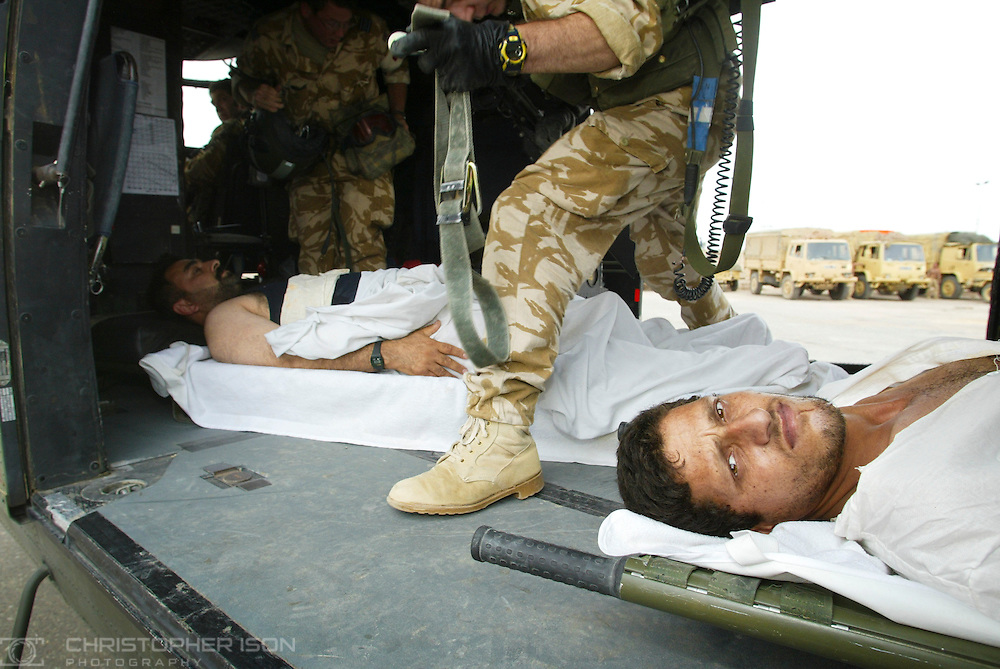 Iraqi men are evacuated by helicopter for emergency medical treatment in southern Iraq.