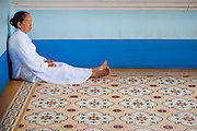 Old woman resting on the floor