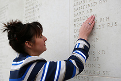 © Licensed to London News Pictures. 02/04/2012.  On the 30th anniversary of the Falklands Conflict Margaret Allen, the wife of the Able Seaman Iain Boldy visits the wall at the National Memorial Arboretum in Alrewas, Staffordshire to take part in a Remembrance service.  During the service Margaret lit a single candle in the Millenium Chapel and took part in a one minute silence to hounour the loss of 255 service men during the conflict.   ..Along with the service those present were invited to view the ongoing work on a new memorial, initiated by the South Atlantic Medal Association (SAMA 82), to remember the 255 UK servicemen who were killed during the Falklands war.  The memorial is set to be dedicated on the 20 May 2012 in the presence of over 600 veterans.  Photo credit: Alison Baskerville/LNP