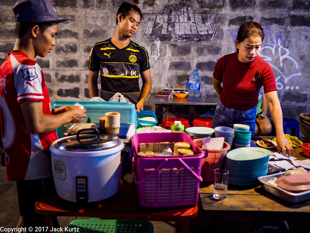 24 MARCH 2017 - BANGKOK, THAILAND: The food prep area of a restaurant that is set up on the sidewalk of Sukhumvit Soi 55 (Thong Lo). The restaurant is being evicted from its location. Food cart vendors along Sukhumvit Road between Sois 55 (Thong Lo) and 69 (Phra Khanong) in Bangkok have been told by city officials that they have to leave the area by 17 April. It's a part of an effort by Bangkok city government, supported by the ruling junta, to take back the city's sidewalks. The evictions in the area are the latest in mass evictions of Bangkok street food vendors after similar actions elsewhere on Sukhumvit, in the Ari area, in Silom/Patpong and Ratchaprasong neighborhoods. The vendors in Thong Lo/Phra Khanong are popular with local office workers because most of the formal restaurants in the area serve foreign tourists and upper class Thais and are very expensive. The street food carts serve meals starting at about 35Baht ($1US). The city has not announced if they will provide alternative locations for the carts.     PHOTO BY JACK KURTZ