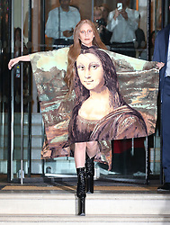 Lady Gaga wearing a Mona Lisa printed dress as she leaves The Langham hotel in London, UK. 04/12/2013<br />BYLINE MUST READ : JAMESY/GOTCHA IMAGES<br /><br />Copyright by © Gotcha Images Ltd. All rights reserved.<br />Usage of this image is conditional upon the acceptance <br />of Gotcha Images Ltd, terms and conditions available at<br />www.gotchaimages.com