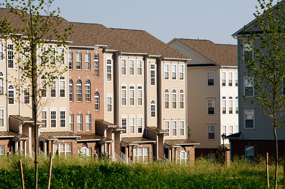 New condominiums and townhouses and empty field near Pleasant Hill Road, Owings Mills, Maryland