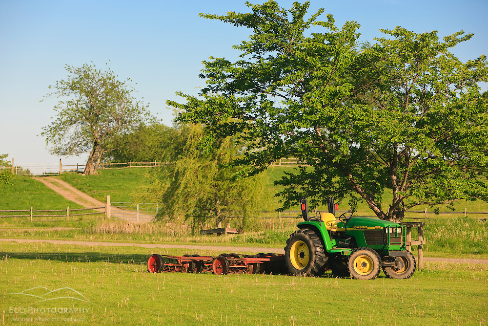A John Deere tractor in a field at the Raymond Farm in Ipswich, Massachusetts.