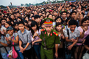 Large audience of young vietnamese people during a show in Hanoi, Vietnam, Southeast Asia